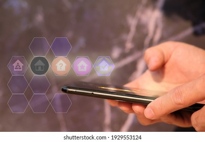 Businessman hand working on smartphone and business icon concept