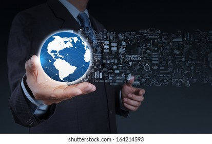 businessman hand the world and business strategy as concept