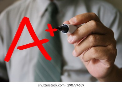 businessman hand write A plus grade,business, technology, internet and networking concept