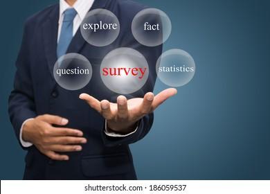 Businessman hand write a survey