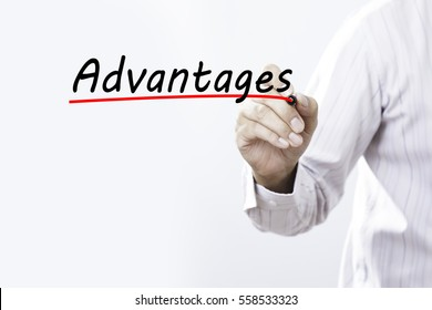 Businessman hand writing advantages with red marker on transparent wipe board, business concept.