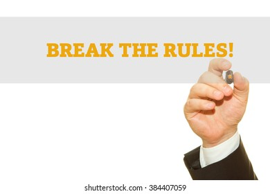 Businessman hand writing Break The Rules isolated on white.