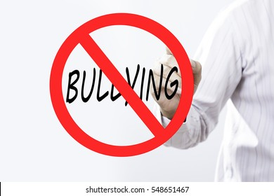 Businessman hand writing bullying prohibition sign concept with  red marker on transparent wipe board. Reduce stress.