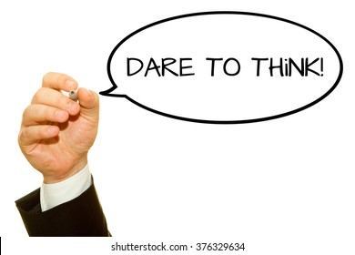 Businessman hand writing DARE TO THINK on a transparent wipe board