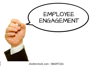 Businessman hand writing Employee Engagement isolated on white.