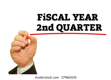 Businessman Hand writing Fiscal Year Second Quarter on a transparent wipe board. Fiscal Year Concept.