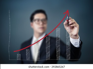 Businessman hand writing graph of growth, new business concept