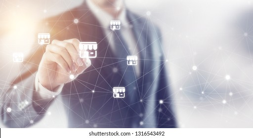Businessman hand writing icon franchise marketing system in global network connection, copy space