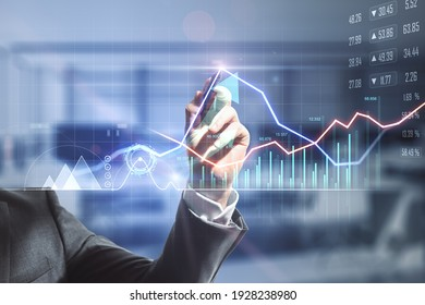 Businessman hand writing on digital screen with financial trade market graphs, diagram and forex chart. Double exposure