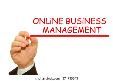 Businessman hand writing Online Business Management with a marker on a transparent wipe board