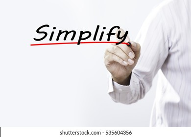 Businessman hand writing Simplify with marker, Business concept