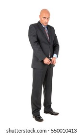 Businessman in handcuffs isolated in white background