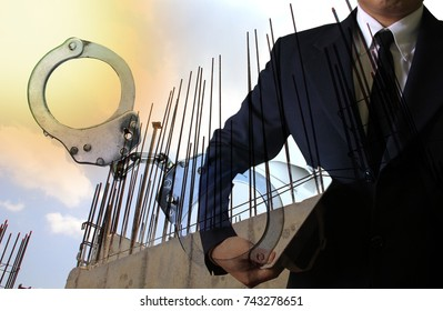 Businessman with handcuffs on construction site , financial Crime,Crime concept