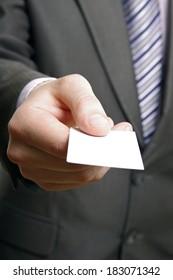 Businessman handing a blank business card