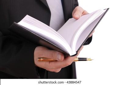 Businessman handing a book and gold pen