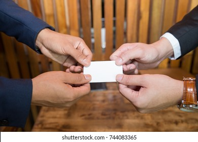 Businessman handing business card. Exchange business card for first time meet. For success business concept.