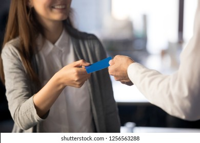 Businessman handing giving visiting business card for businesswoman client customer sharing offering personal information, introduction, exchanging contacts and networking concept, close up view