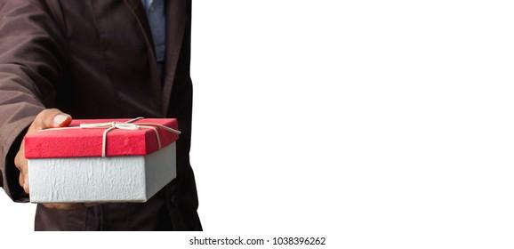 Businessman handing a heart shaped gift box.
