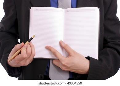 Businessman handing an open book