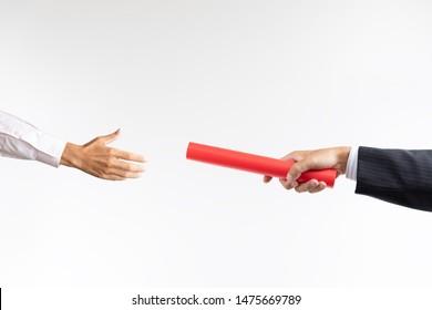 Businessman handing over baton to the next generation