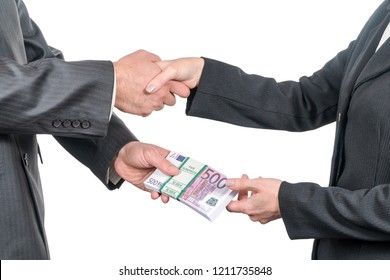 businessman handing a pack of euro money to a woman shaking her hand isolated on white background