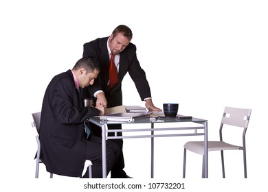 Businessman Handing a Pen to Another to Sign a Contract