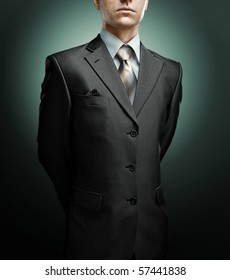businessman with hands behind