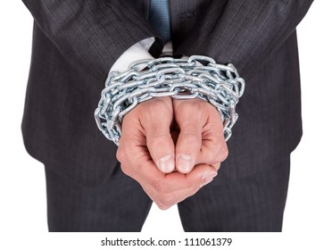 Businessman hands bound in chains. Isolated on white