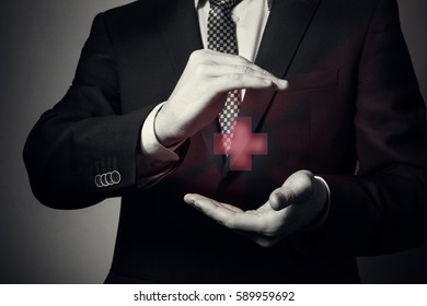 businessman hands closeup. a man in business suit shows caring gesture. life and health insurance.