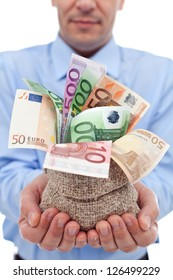 Businessman hands with euro banknotes in a money bag - closeup