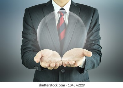 Businessman hands holding empty transparent sphere