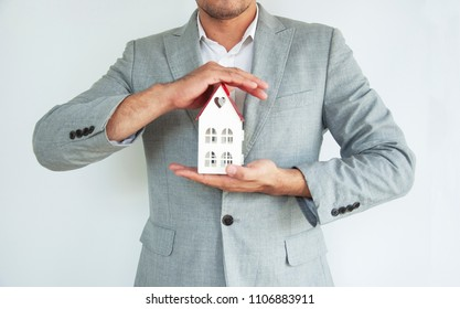 Businessman hands holding mock up house, family home, homeless housing and real estate, insurance , financial, Invesment, Construction concept