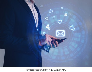 Businessman hands holding phone with icon mail, comment, follower, like, love and address. Customer service call center  concept