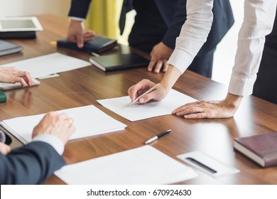 businessman hands with pen over document