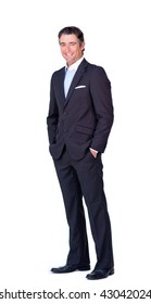 Businessman with hands in the pocket isolated on a white background