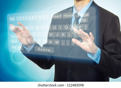 Businessman Hands pushing a button on a touch screen, virtual keyboard