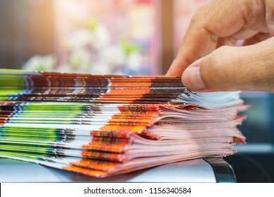 Businessman hands searching Stack of Brochure report paper documents for business desk, Business papers for Annual Report files, Business offices concept, soft focus