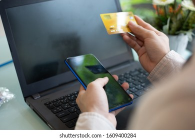 businessman hands searching for using credit card for online shopping.