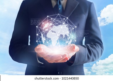 Businessman in hands touching digital global network.