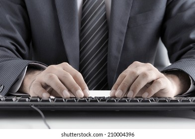 Businessman hands typing computer keyboard - retro style lighting effect