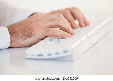 Businessman hands typing on keyboard on white background