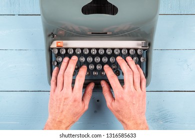 businessman hands writing on an old typewriter