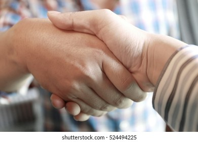 Businessman handshake for closing the deal after singing the lucrative contract between companies.Trust business partner