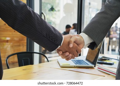 Businessman handshake,businessman shaking hands to seal a deal with his partner