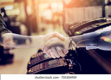 businessman handskae with Credit card payment, buy and sell products & service business ideas concept