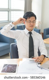 Businessman handsome headphones plugged into his head