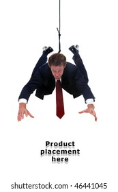 Businessman hanging by a rope, place an image of your product underneath him.