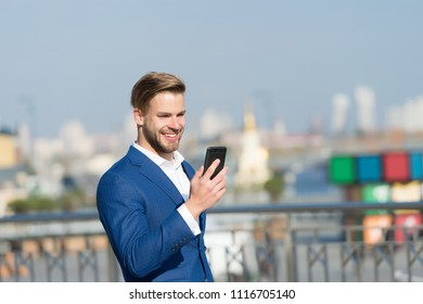 Businessman happy smiling use smartphone for video call or texting, skyline background. Business call concept. Man in suit businessman takes advantages of modern mobile technologies for business.
