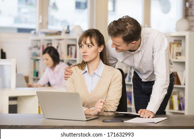 Businessman harassing his colleague at work