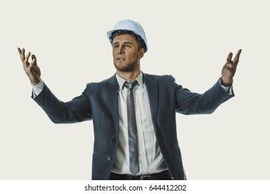 Businessman in hard hat holding copyspace.